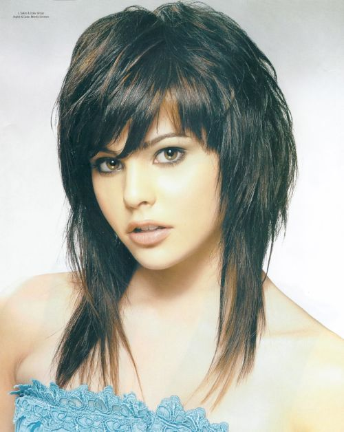 Here Is Another Classic Feather Hairstyle With Feathered Bangs And Soft Curls